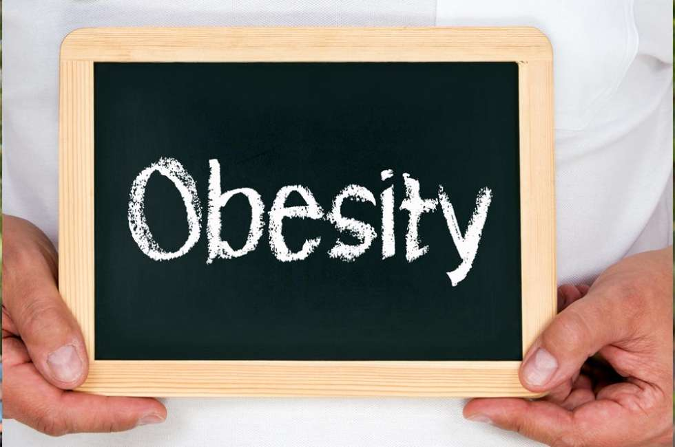 Doctor Holding Obesity signboard