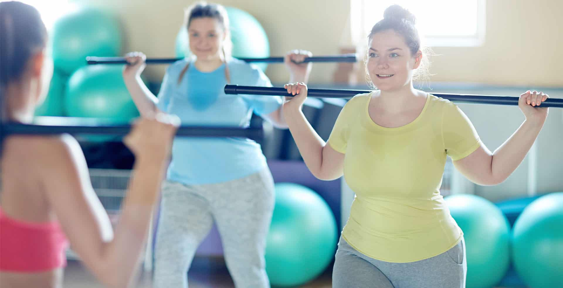 Girls exercising with trainer