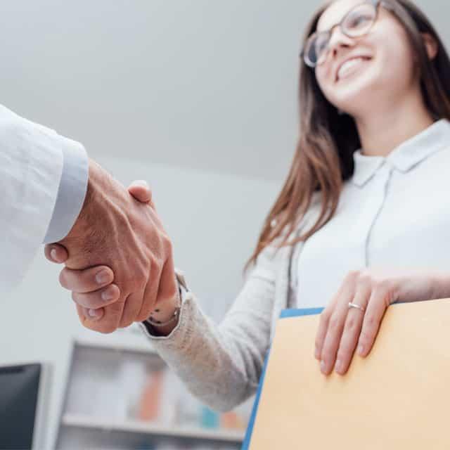 Patient shaking doctors hand